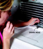 Blowing out a Blocked Defrost Drain Line